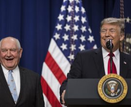 Sonny Perdue, Donald Trump are posing for a picture